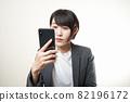 Woman suit smartphone 82196172