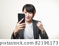 Woman suit smartphone 82196173