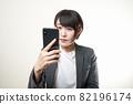 Woman suit smartphone 82196174