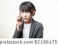 Woman suit smartphone 82196175