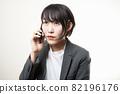 Woman suit smartphone 82196176