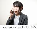 Woman suit smartphone 82196177