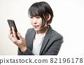 Woman suit smartphone 82196178
