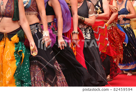 Row of Belly Dancers in Costune Before Performance 82459594