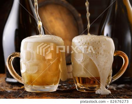 frothy beer mug in the cellar 82676273