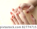 Hands with brown marble nails 82774715