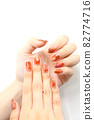 Hands with brown marble nails 82774716
