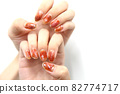 Hands with brown marble nails 82774717
