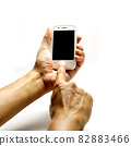man hand hold phone isolated on white 82883466