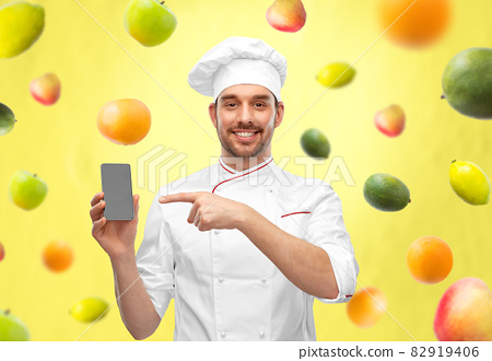 happy smiling male chef showing smartphone 82919406
