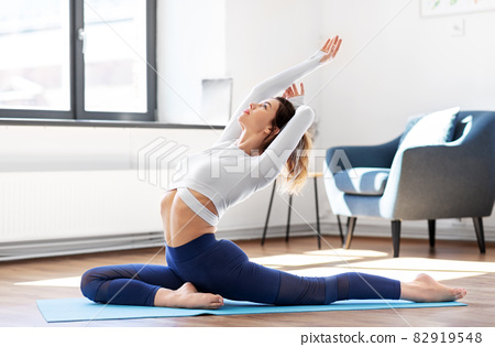 young woman doing yoga at studio 82919548