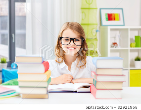 smiling student girl with books learning at home 82921968
