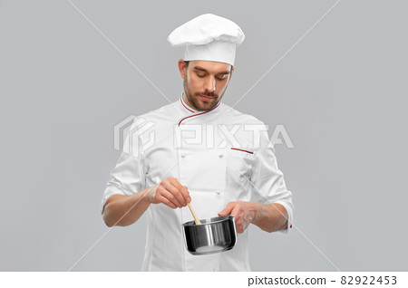 male chef with saucepan cooking food 82922453