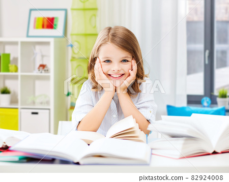 smiling student girl with books learning at home 82924008