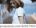 Woman at the seaside 82937463