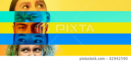 Collage of close-up male and female eyes isolated on colored neon backgorund. Multicolored stripes. 82942590