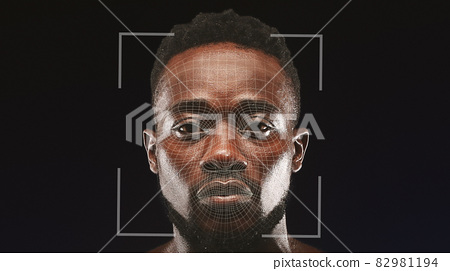 Digital face scan of young serious black guy, isolated on black background 82981194