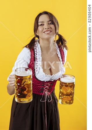 Oktoberfest server smiling with beer 82986404