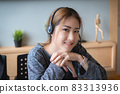 Customer service representative with a headset and work at home. business support team concept. 83313936