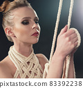Pretty woman tied up with rope portrait 83392238
